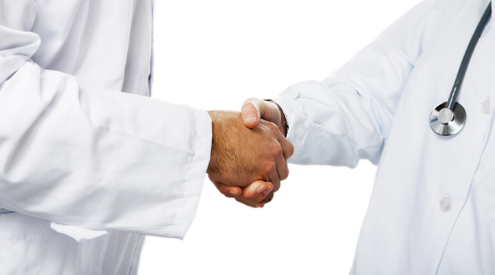 healthcare and medicine: doctors shaking hands
